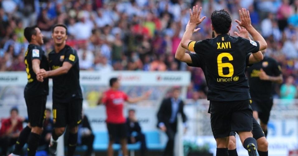 Xavis comemora após abrir o placar para o Barcelona contra a Real Sociedad pelo Campeonato Espanhol