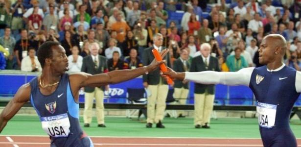 Campeão olímpico dos 400 m rasos, Michael Johnson participa do 4 x 400 m com o quarteto dos EUA, que também levou o ouro