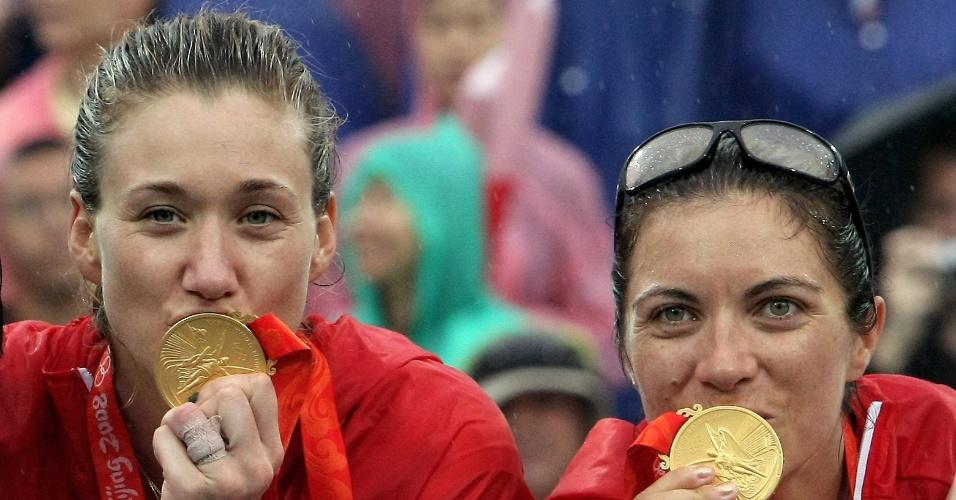 Walsh (à esq.) e May, dupla norte-americana de vôlei de praia, campeãs olímpicas sem perder nenhum set