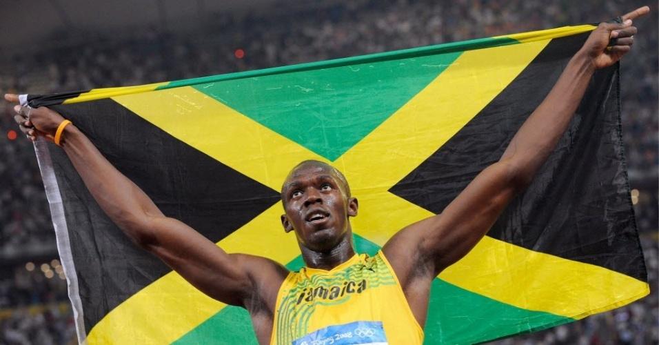 Usain Bolt comemora sua vitória nos 100 m rasos nos Jogos Olímpicos-2008