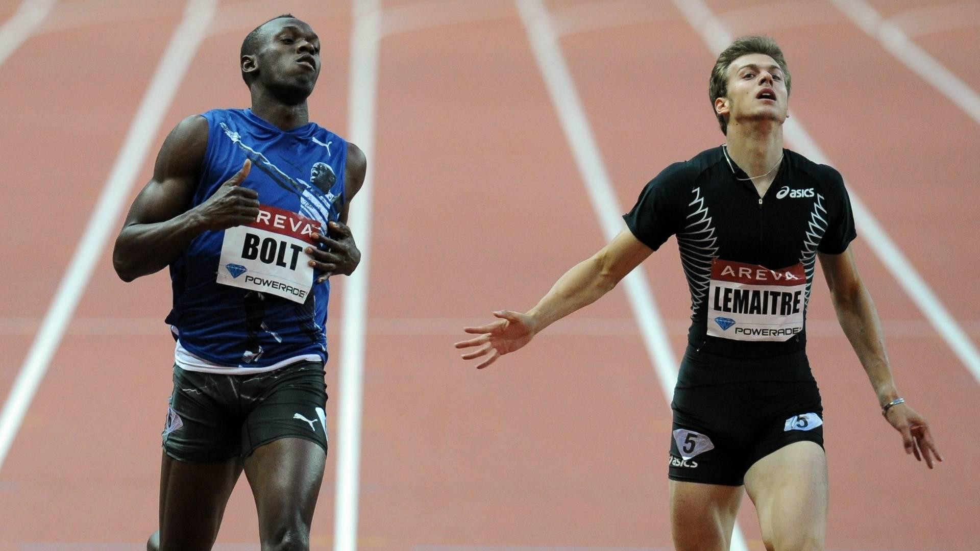 Usain Bolt (esquerda) venceu prova dos 200m na Liga de Diamante, seguido de C. Lemaitre (08/07/2011)