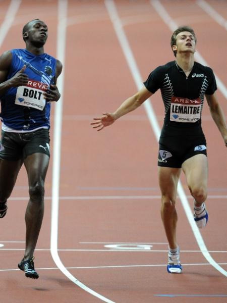 Usain Bolt (esquerda) venceu prova dos 200m na Liga de Diamante, seguido de C. Lemaitre (08/07/2011) - Franck Fife/ AFP Photo