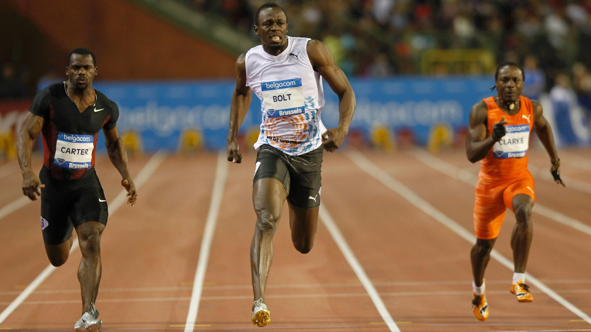 Usain Bolt (c) vence a etapa de Bruxelas da Liga de Diamante; Nesta Carter (e) foi o segundo, e Lerone Clarke (d) foi o terceiro (16/09/2011)