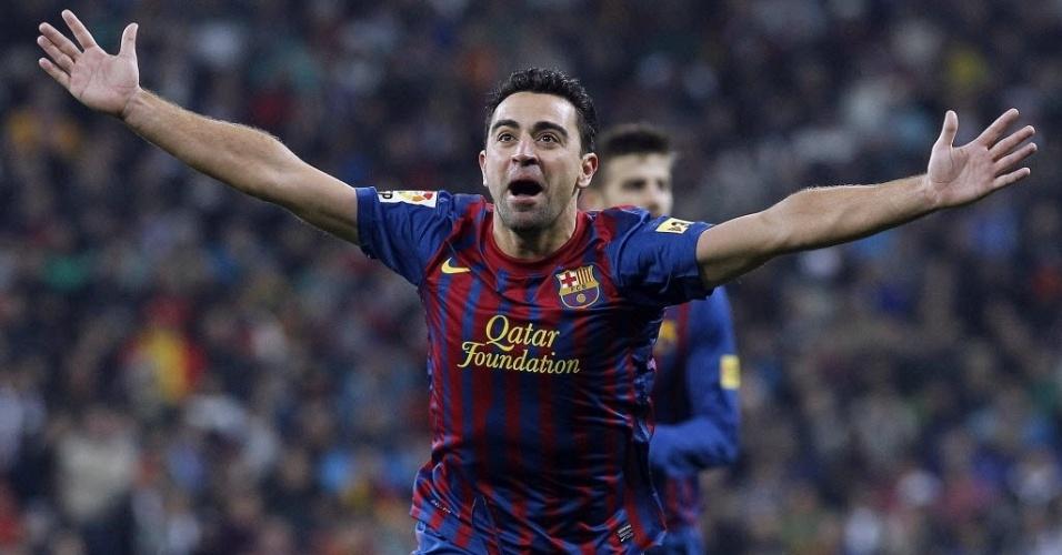 Xavi comemora gol diante do Real Madrid pelo Espanhol