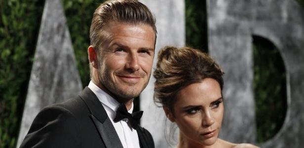David Beckham e sua esposa Victoria posam para fotógrafos ao chegarem em uma festa pós-Oscar, na California (26/02/2012) - Danny Moloshok/Reuters