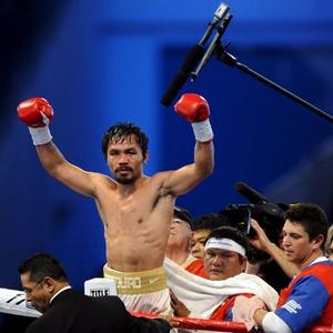 Filipino Manny Pacquiao comemora vitória sobre Antonio Margarito em Dallas, nos EUA