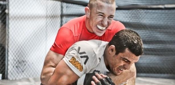 Campeão dos meio-médios do UFC, Georges St-Pierre visita Vitor Belfort para treino