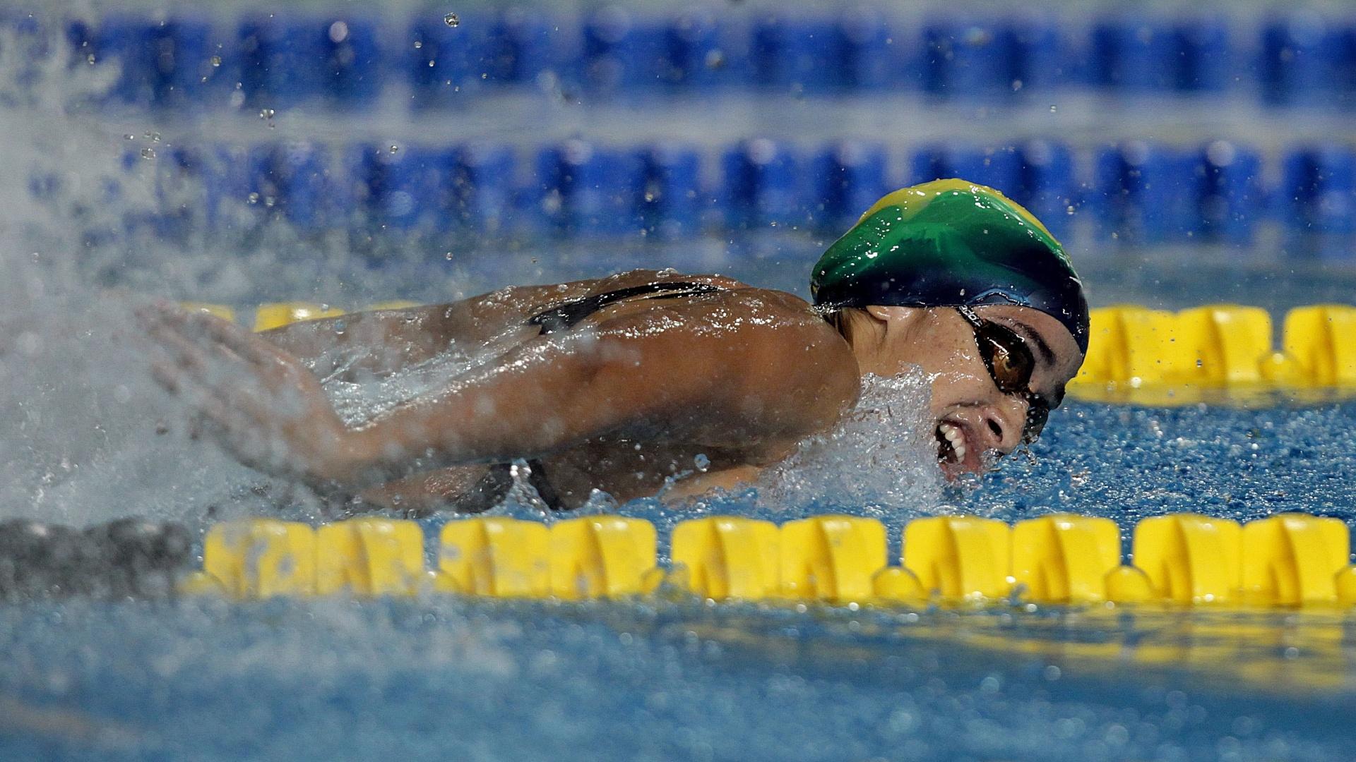 Daynara de Paula bateu na primeira colocação nas eliminatórias dos 100m borboleta, com 1min01s39, segundo o placar do ginásio no México (15/10/2011)