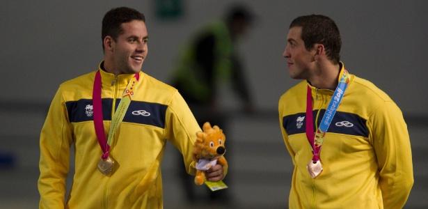 Thiago Pereira e Guilherme Guido foram ouro e bronze nos 100 m costas nesta segunda