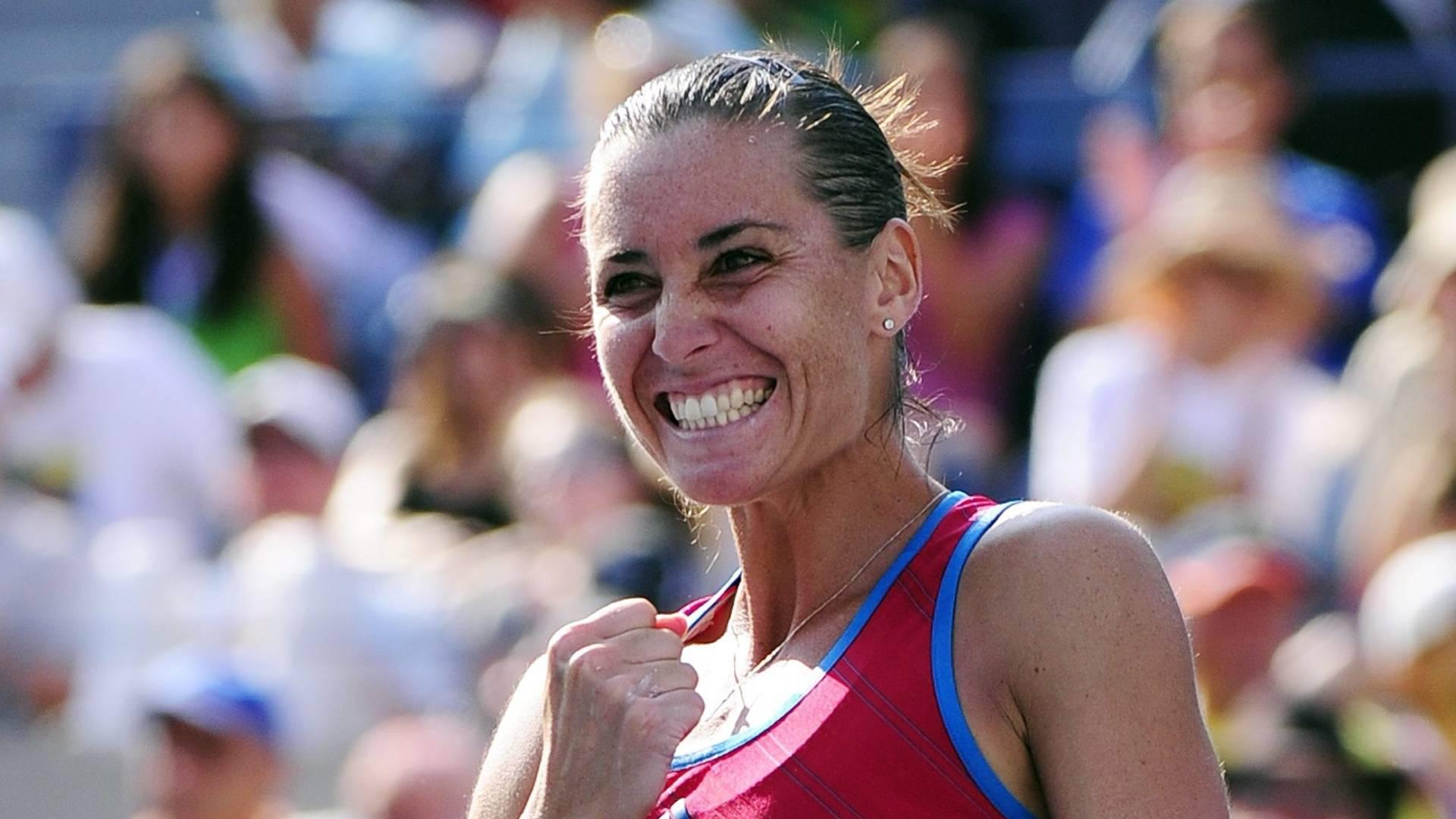 A tenista italiana Flavia Pennetta festeja a vitória sobre a russa Maria Sharapova em jogo válido pela terceira rodada do US Open